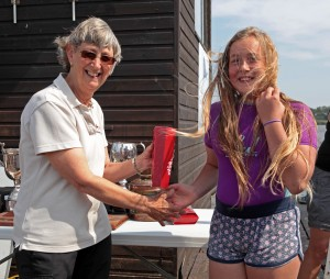 Elske Wilton receives her prize for 1st lady crew from NPC Commodore Fil Daniels. Photo by Robin Myerscough